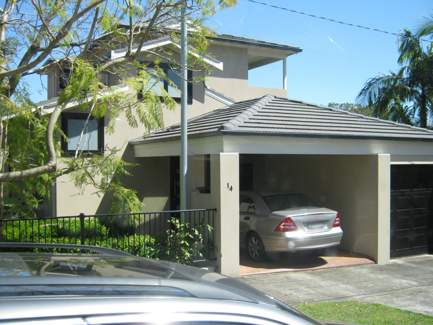 Adding a carport to your home attractive carports for Adding onto a house ideas